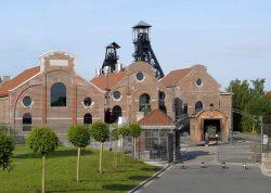 Закрытая шахта Bois du Cazier в Бельгии, разрушенная пожаром 1956 года, который унёс жизни 262 горняков.